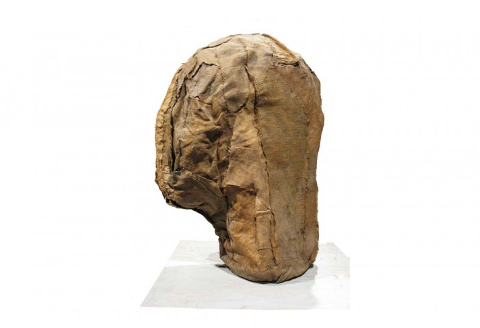 <i>Head</i>, 1974<br>Burlap with resin, 36 x 26 x 19 3/4 inches. <br>Gift of Sirje and Michael Gold