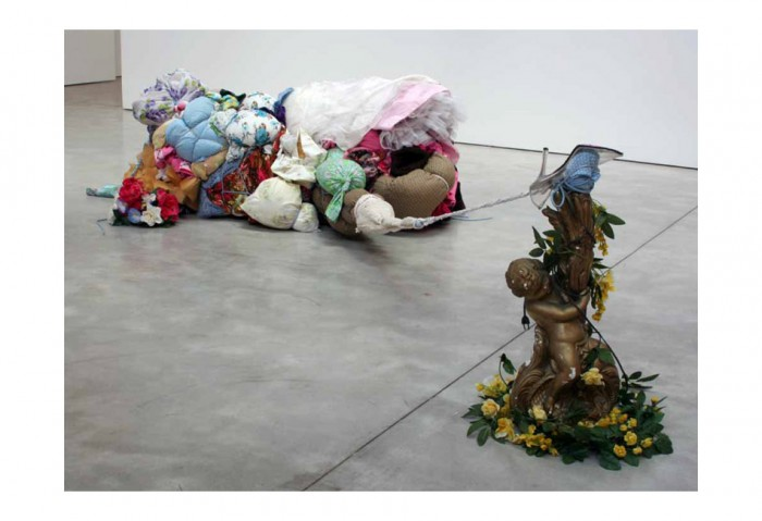 <i>And, she has a bowl of lilacs in her room</i>, 2008<br>Clothing, fabric, books, foam, ribbon, rope, binding, carpet and found objects, 30 x 68 x 52 inches (76.2 x 172.72 x 132.08 cm)<br>Gift of the Artist