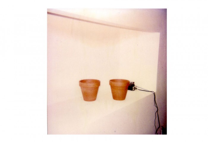 <i>Two Flower Pots with Ash</i>, 1987<br>Clay pots, speakers, ash, walkman with audio tape, and wire<br>Gift of the Lannan Foundation