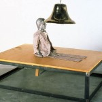 Attempt to Raise Hell, 1974Wood and metal platform, brass bell, and dummy doll, 42 x 60 x 1 inches (106.68 x 152.4 x 2.54 cm)Partial gift of the Oppenheim Foundation and purchased with funds provided by Dennis and Debra Scholl