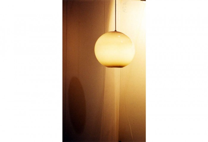 <i>Round Light, Darker on the Bottom</i>, 1997<br>Glass, electrical fixture, and cord, 14 x 14 x 14 inches (35.56 x 35.56 x 35.56 cm)<br>	Purchased with funds provided by Rosa and Carlos de la Cruz
