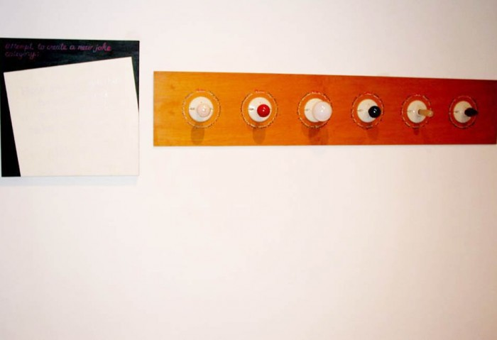 <i>New Joke Category</i>, 1992<br>Acrylic on canvas, wood, metal, ceramic, fixtures and lightbulbs,	24 x 96 x 6 inches (60.96 x 243.84 x 15.24 cm)<br>Gift of Peter Norton