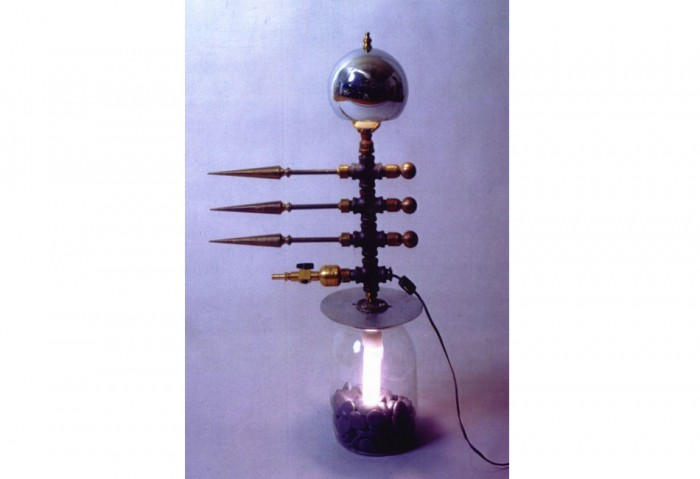 <i>Bug Light</i>, 1992-1993<br>Glass, chromed steel, rocks, electrical lights, and brass, 30 x 16 x 8 inches (76.2 x 40.64 x 20.32 cm)<br>Gift of Peter Norton