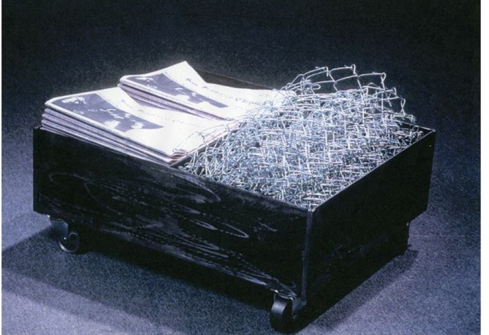 <i>Split Cart</i>, 1991<br>Newspaper, steel, galvanized steel, 28 x 23 x 12 inches (71.12 x 58.42 x 30.48 cm)<br>Gift of Peter Norton