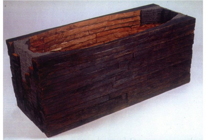 <i>Untitled</i>, 1986<br>Cedar, graphite, and felt, 22 x 53 1/2 x 21 1/4 inches (55.88 x 135.89 x 53.98 cm)<br>Gift of Eileen and Peter Norton