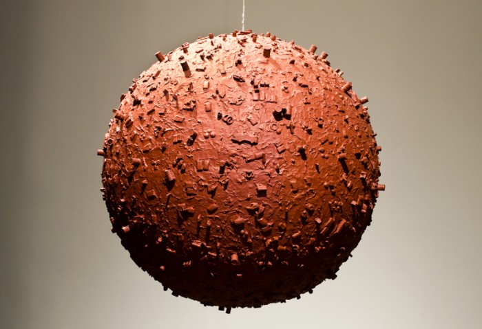 John Miller, <i>Storage Area</i>, 1993. Acrylic and assorted objects on styrofoam sphere, 30 inches in diameter. Collection of Museum of Contemporary Art, North Miami. Gift of Peter Norton