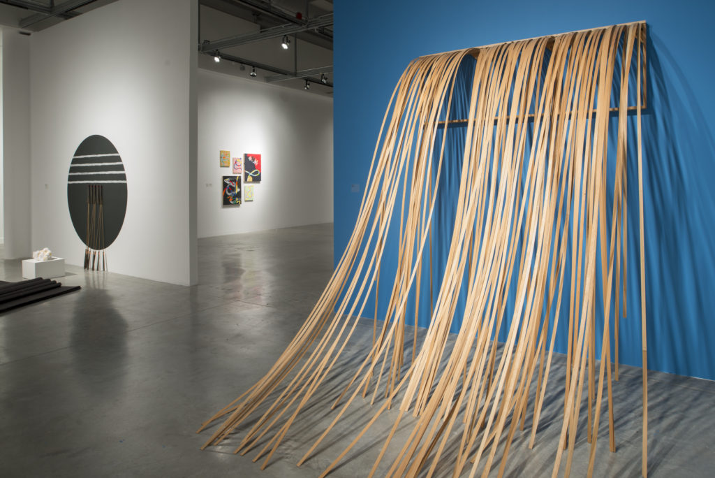 "MARY VALVERDE Untitled (Altar), 2014 (left) TRUMAN LOWE Waterfall, 1993 (right) / To create 'Waterfall,"" Lowe affixed individual strips of pine splints onto into a series of grids."