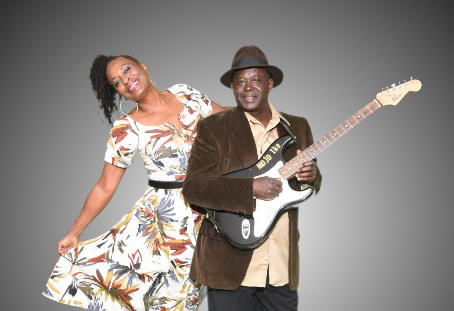 photo of mojo ike with guitar and val woods
