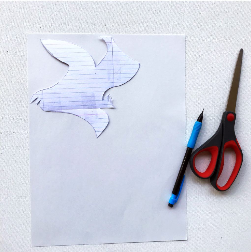 Once you've taped it back together, take your sheet of paper and trace your shape onto the top left corner.