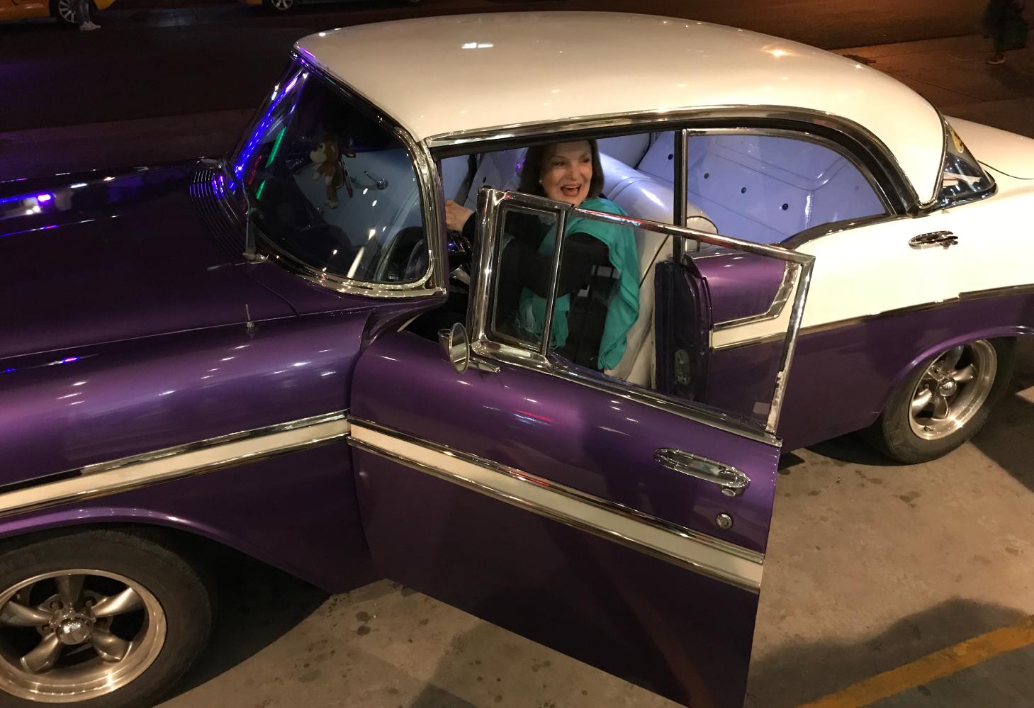 suzanne delehanty in an old Purple Car
