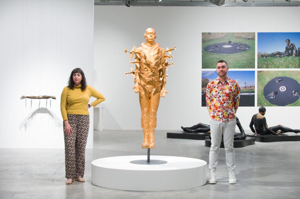 curators Melissa Levin and Alex Fialho next to Tar Baby vs. St. Sebastian